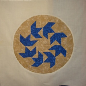 Circling Swans in a block that didn't make it into another quilt I was working on, so I just cut it down to put in a circle for Big Wheels.  Is that cheating?