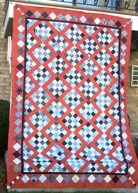 "Still Searching for a name for this quilt. It's the one I had originally started in tribute to Maryellen Hopkins, but then pulled the Dugout blocks out because they were the ""wrong"" color of red... Hmmm. That sounds like a good name for a quilt The Wrong Color of Red!"